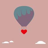 Shipping a heart shaped symbol using a hot air balloon.