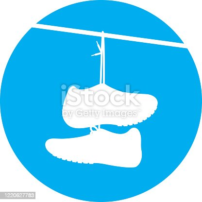istock Shoes Hanging on Wire Icon Silhouette 1220627783