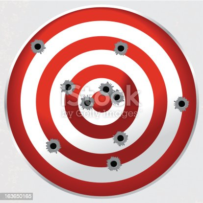 Red and white shooting range gun target shot full of bullet holes. File is layered for easy separation of bullet holes, target, and background.
