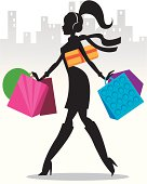 The silhouette of a girl with shopping bags, dressed for cold weather with a scarf, boots, and ear muffs.