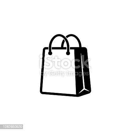 istock Shopping bag icon in black. Eco paper bag. Handbag icon. Vector on isolated white background. EPS 10. 1282650520