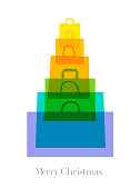 Colourful overlapping silhouettes of shopping bags in shape of Christmas Tree. EPS10 file best in RGB. CS5 version in zip