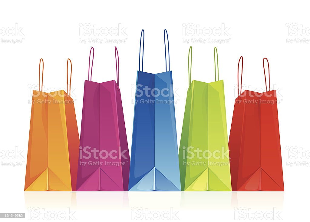 Shopping bags in a row on white - vector vector art illustration