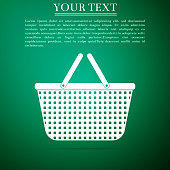 Shopping basket icon isolated on green background. Flat design. Vector Illustration