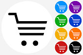 Shopping Cart Icon. The icon is black and is placed on a round blue vector button. The button is flat white color and the background is light. The composition is simple and elegant. The vector icon is the most prominent part if this illustration. There are eight alternate button variations on the right side of the image. The alternate colors are orange, red, purple, yellow, black, green, blue and indigo.