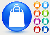 Shopping Gift Bag Icon. The main icon is placed on a flat blue background. It takes up the center portion of the composition and is the main focus of this vector illustration. The icon is simple and the background further emphasizes the icon shape and makes it stand out. The illustration is a 100% royalty free vector.. The icon is white and is placed on a round blue vector button. The button has a sight shadow and the background is light. The composition is simple and elegant. The vector icon is the most prominent part if this illustration. There are eight alternate button variations on the right side of the image. The alternate colors are orange, red, purple, maroon, light blue, green, teal and indigo.