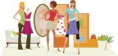 Groip of women trying on clothes at a store