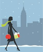A girl shopping in New York with the snow falling.