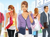 Young brunette woman with shopping bags walking on a crowded street. Seperated to layers for easy editing.