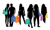 Group of young people out shopping with colorful shopping bags