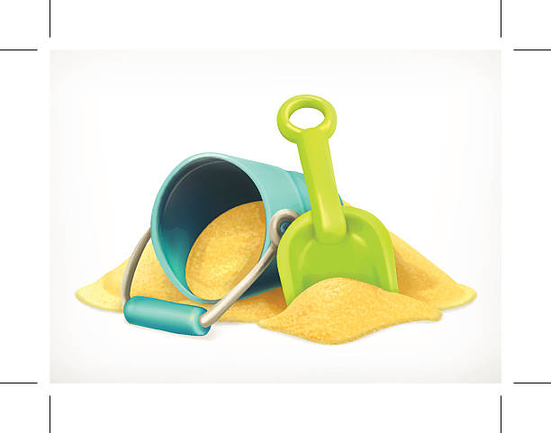 Shovel and bucket in the sand vector art illustration