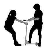 Brother and sister fighting over the use of a scooter