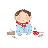 Sick boy with flu standing behind the table with hot tea, medicine, thermometer and paper handkerchief - original hand drawn illustration