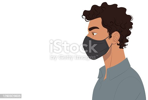 istock Side view of a man wearing mask 1290925605
