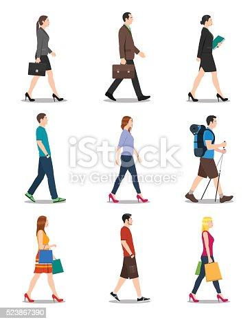 istock Side View of Men and Women Walking 523867390