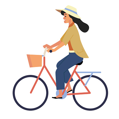 Side view of woman with hat riding a retro bicycle