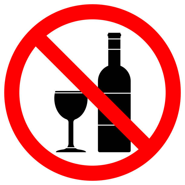 NO ALCOHOL sign. Wine bottle and cup icons in crossed out red circle. Vector NO ALCOHOL sign. Wine bottle and cup icons in crossed out red circle. Vector. alcohol drink symbols stock illustrations