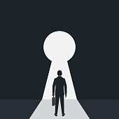 Silhouette businessman in suit standing in front of keyhole