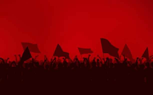 Silhouette group of people Raised Fist and flags Protest in flat icon design with red color sky background Silhouette group of people Raised Fist and flags Protest in flat icon design with red color sky background riot stock illustrations