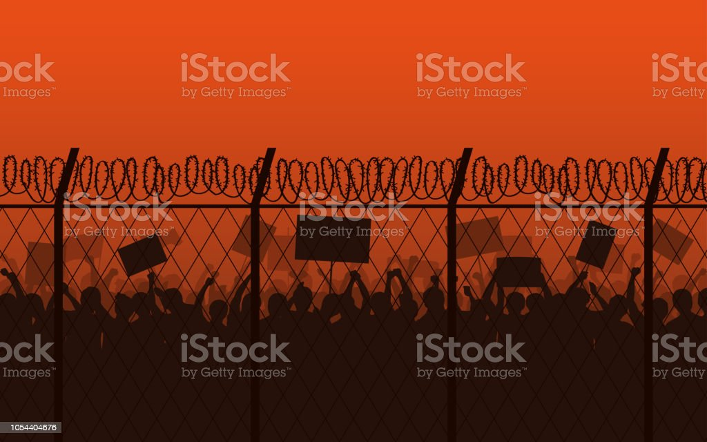 Barbed Wire Signs | Silhouette Group Of People Raised Fist And Protest Signs At Evening