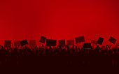 Silhouette group of people Raised Fist and Protest Signs in flat icon design with red color sky background