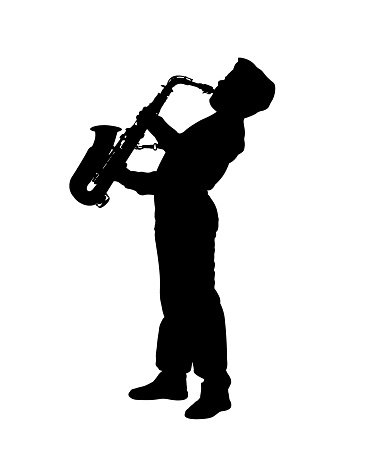 Silhouette of a boy playing the saxophone