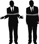 Silhouette of a businessman tied up with chain