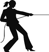 A silhouette of a businesswoman pulling on a rope
