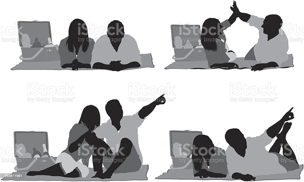 Silhouette of a couple at picnic vector art illustration