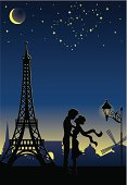 Silhouette of a couple in Paris. Stars in a shape of heart in the sky.