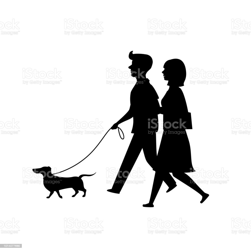 silhouette of a couple walking together with dachshund dog