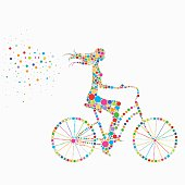 bright colored silhouette of a girl on a bicycle