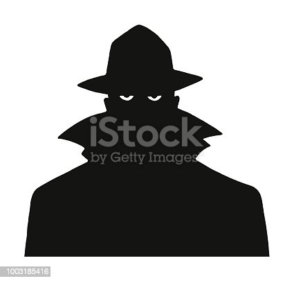 Silhouette of a Man in a Trench Coat and Hat