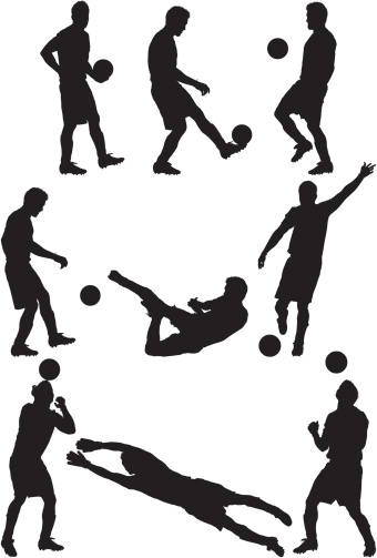 Silhouette of a man playing soccer