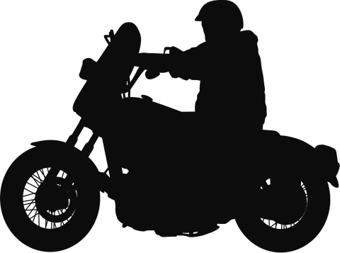 Silhouette of a man riding motorcycle