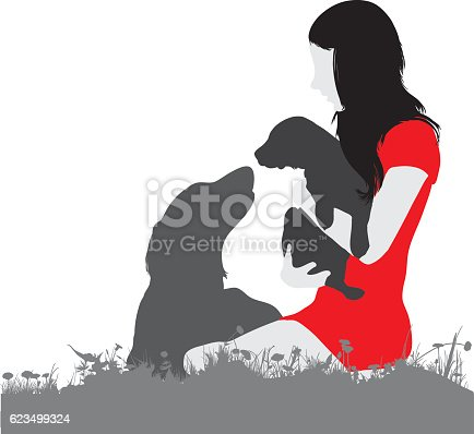 Silhouette of a woman, dog and puppy on her lap