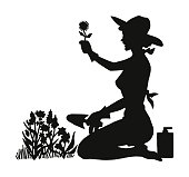 Silhouette of a Woman Gardening