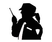 Silhouette of a woman security guard with uniform and walkie talkie.