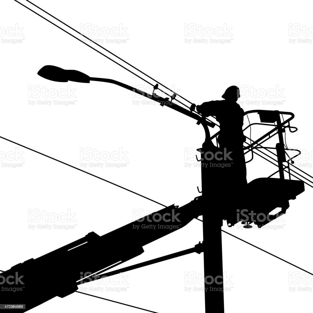 Silhouette of an electrician working on a street light vector art illustration