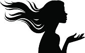 Stock vector illustration of a silhouette of a beautiful girl in profile with long hair isolated on a white background