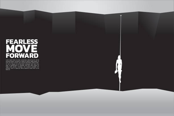 silhouette of businesswomen with briefcase walking on the rope to cross abyss. concept of business risk, challenge and courage women ravine stock illustrations