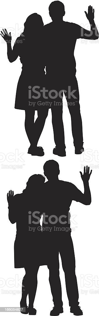 Silhouette of couple waving hands royalty-free stock vector art