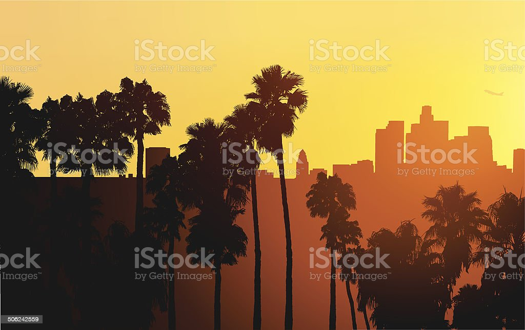 Silhouette Of Downtown Los Angeles At Sunset With Palm Trees vector art illustration