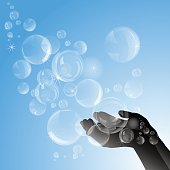 Silhouette of female hands with soap bubbles.