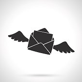 Silhouette of flying opened envelope with wings
