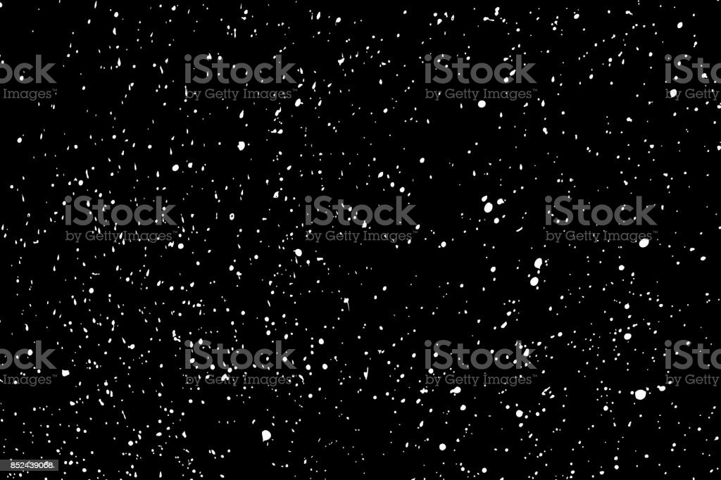 Silhouette of food flakes such as salt or almond or wheat flour spread on the flat surface or table. Abstract grainy texture isolated on black background. Top view of dust, sand blow or bread crumbs.
