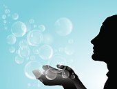 Silhouette of girl with soap bubbles.