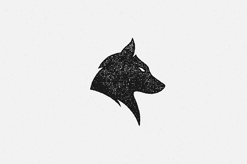Silhouette of head wild wolf as symbol wildlife hand drawn stamp effect vector illustration. Vintage grunge texture on old paper for poster or label decoration.