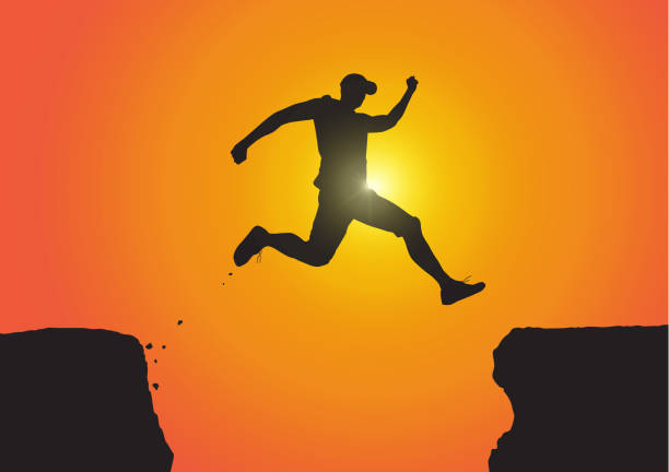 silhouette of man jumping over the cliffs on golden sunrise background, achievement, success and winning concept vector illustration - jumping stock illustrations