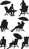 Silhouette of people deck chairs